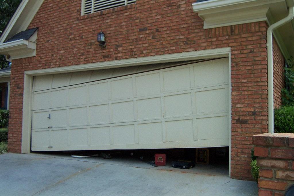 Dangers of Repairing a Faulty Garage Door Yourself
